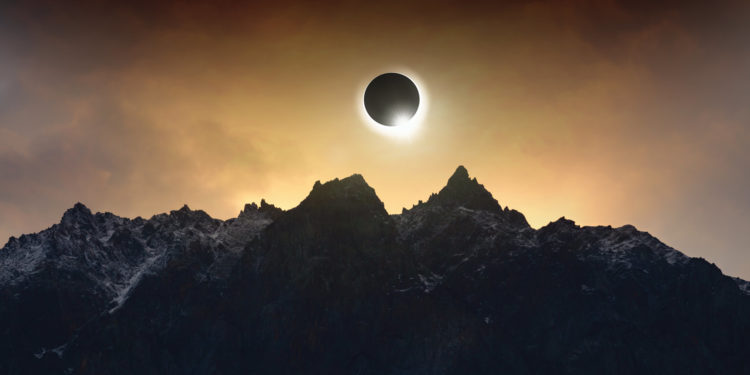 Solar eclipse over the antarctic landscape