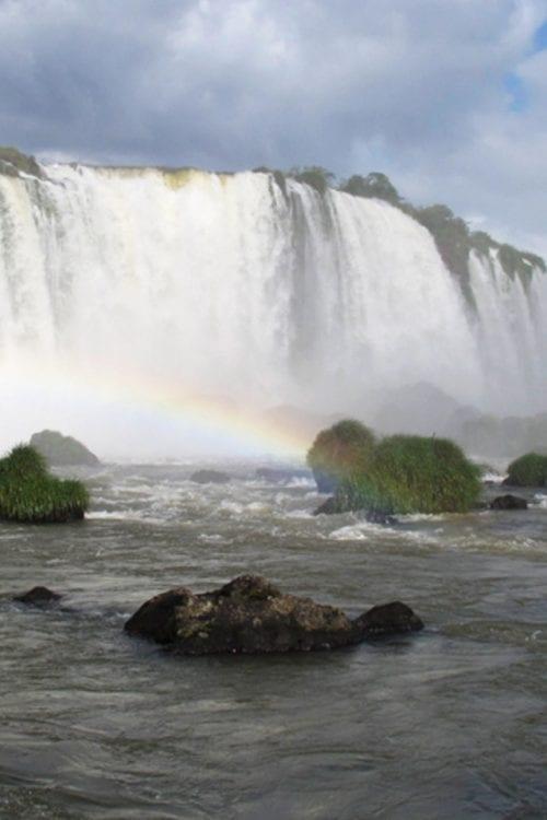 Brazil rainbow in Iguazu Falls Contours Travel