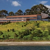 Chile Tierra Chiloe new building from beach