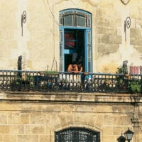 Lovers in a window travel to Cuba Havana Contours Travel