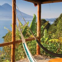 Hammocks on a terrace with view of Lake Atitlan in Guatemala Contours Travel