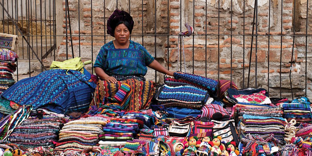 Lady selling textiles in Antigua Guatemala Contours Travel