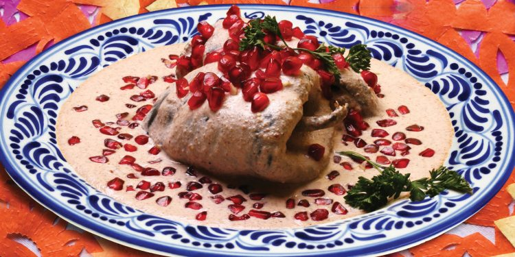 Contours Travel Chiles en Nogada with walnut sauce and pomegranate seeds