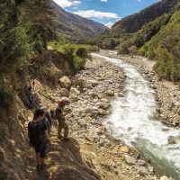 Peru Mountain Lodges Salkantay people walking Contours Travel