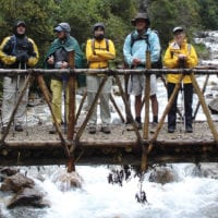 Peru Mountain Lodges Salkantay people on bridge on the way to Lucma Lodge Contours Travel