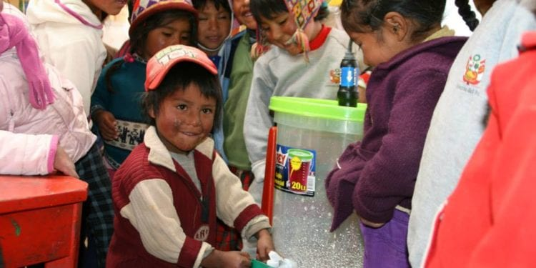 Contours Travel Agua Pura community project. Water filter donation recipient in Sacred Valley